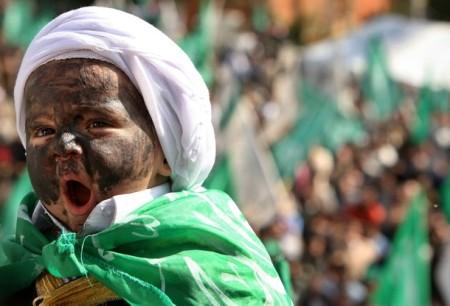 Palestinskt barn utklätt till Omar al-Bashir. Reuters 6 mars 2009