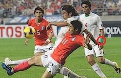 Iranska landslaget bär gröna armbindlar